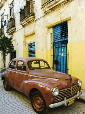 Vintage Car Parked Outside House in Vieja District by Christian Aslund