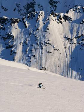 Woman Skiing on Daltinden in Midnight Sun by Christian Aslund