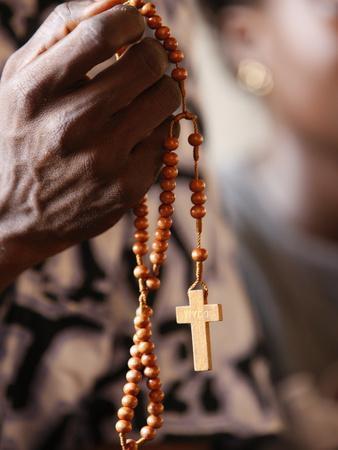https://imgc.allpostersimages.com/img/posters/christian-couple-praying-togoville-togo-west-africa-africa_u-L-PFNXLN0.jpg?p=0