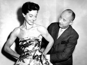 Christian Dior with Model Dorothy Emms, 1952