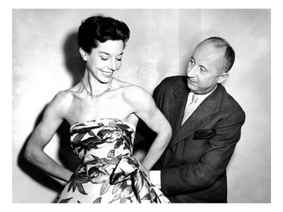 https://imgc.allpostersimages.com/img/posters/christian-dior-with-model-dorothy-emms-1952_u-L-P9PXYX0.jpg?p=0