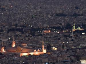 Aerial View of City at Night Including the Umayyad Mosque, Damascus, Syria by Christian Kober