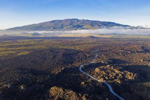 Aerial view of volcanic landscape and Mauna Kea, 4207m, Big Island, Hawaii, USA by Christian Kober