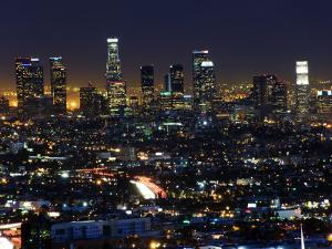 California, Los Angeles, City Lights and Downtown District Skyscrapers, USA by Christian Kober