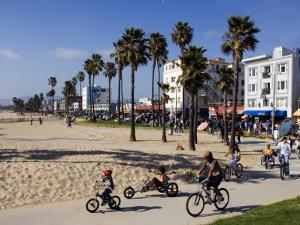 California, Los Angeles, Venice Beach, People Cycling on the Cycle Path, USA by Christian Kober