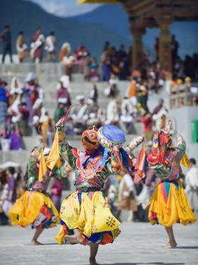 Dancers in Traditional Costume, Autumn Tsechu (Festival) at Trashi Chhoe Dzong, Bhutan, Asia by Christian Kober