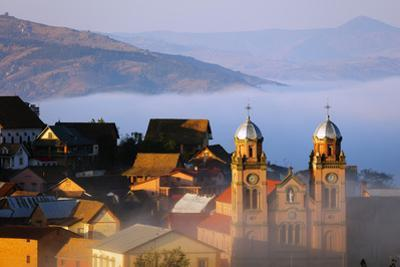 Early morning mist on the Haute Ville old town, Ambozontany Cathedral, Fianarantsoa, central area,  by Christian Kober