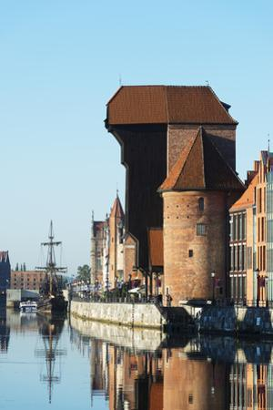 Europe, Poland, Gdansk, Canal Side Houses and Gdansk Crane by Christian Kober