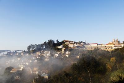 Fianarantsoa, early morning mist on the Haute Ville old town, central area, Madagascar, Africa by Christian Kober