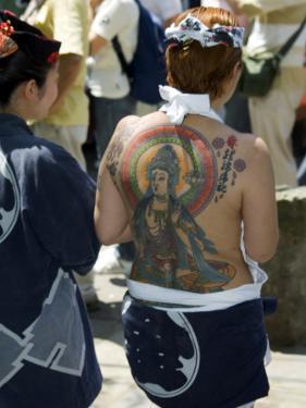 Girl with Shiva Tattoo on Back, Sensoji Temple, Asakusa, Japan by Christian Kober