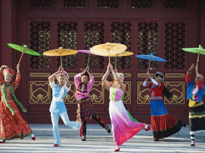 Girls Dancing with Coourful Parasols at the Ethnic Minorities Park, Beijing, China, Asia