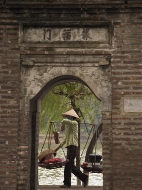 Lady Carrying Baskets, Hoan Kiem Lake, Hanoi, Northern Vietnam, Southeast Asia by Christian Kober