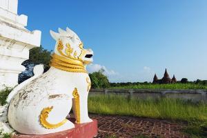 Lion Statue and Temple on Bagan Plain, Bagan (Pagan), Myanmar (Burma), Asia by Christian Kober