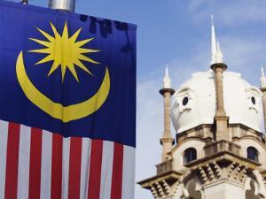 Malaysian Flag and Old Kl Railway Station, Kuala Lumpur, Malaysia, Southeast Asia, Asia by Christian Kober