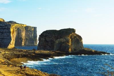 Mediterranean Europe, Malta, Gozo Island, Dwerja Bay, Hikers at Fungus Rock