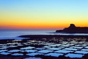 Mediterranean Europe, Malta, Gozo Island, Salt Pans at Sunrise, Xwejni Bay by Christian Kober