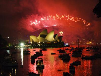 New South Wales, Sydney, Opera House and Coathanger Bridge with Boats in Sydney Harbour, Australia by Christian Kober