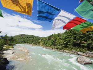 Prayer Flags on a Bridge, Bumthang, Chokor Valley, Bhutan, Asia by Christian Kober