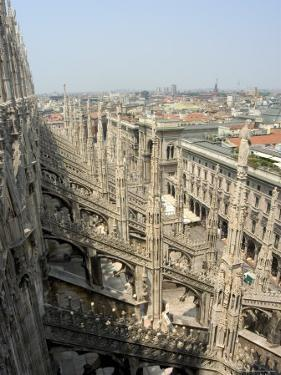 Rooftop Spires of Duomo Cathedral and City, Milan, Lombardy, Italy by Christian Kober