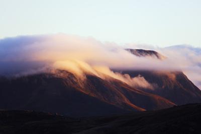 Sunrise on a cloud topped mountain, Andringitra National Park, Ambalavao, central area, Madagascar, by Christian Kober