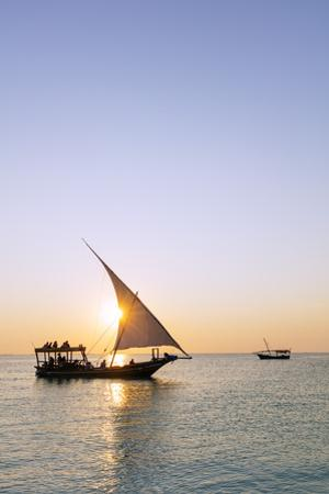 Tourists on a sunset cruise on the Indian Ocean, Nungwi, Island of Zanzibar, Tanzania, East Africa by Christian Kober