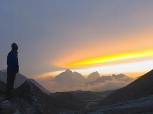 Trekker Watching the Sunset Over Cholatse, 6335M, Sagarmatha National Park, Himalayas by Christian Kober