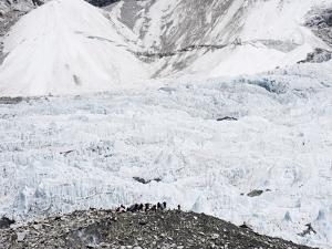 Trekkers Below the The Western Cwm Glacier at Everest Base Camp, Himalayas by Christian Kober