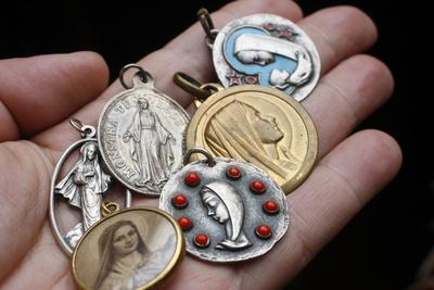 https://imgc.allpostersimages.com/img/posters/christian-medals-saint-gervais-haute-savoie-france_u-L-Q1GYLQX0.jpg?artPerspective=n