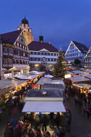 https://imgc.allpostersimages.com/img/posters/christmas-fair-in-the-market-place-with-stiftskirche-church_u-L-PQ8UXH0.jpg?p=0