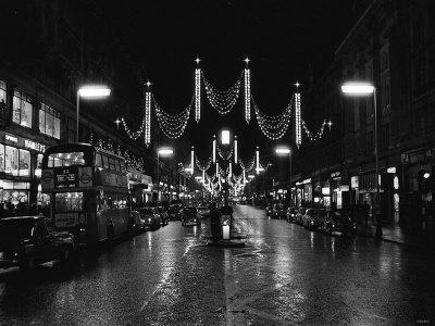 https://imgc.allpostersimages.com/img/posters/christmas-lights-and-decorations-in-regent-street-london-1966_u-L-P5F4M30.jpg?p=0