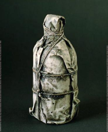 Wrapped Bottle, c.1958 by Christo
