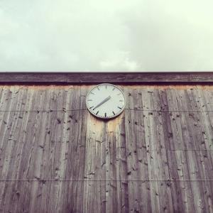 Clock on Wooden Wall by Christoph Hetzmannseder