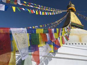 Prayer Flags Flutter from the Apex of Bodnath Stupa, Kathmandu, Nepal by Christopher Bettencourt