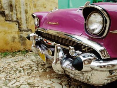 1957 Chevy Bel-Air Car Front Grill and Bumper in Cobbled Street, Trinidad, Cuba by Christopher P Baker