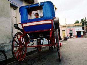 Girl in Horse-Drawn Carriage Taxi, Parque Cespedes, Bayamo, Cuba by Christopher P Baker
