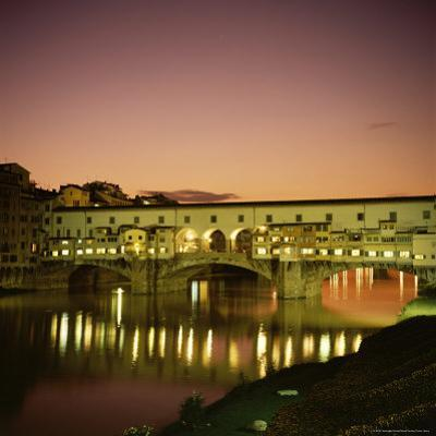 Reflections of the Ponte Vecchio Dating from 1345, Tuscany, Italy by Christopher Rennie