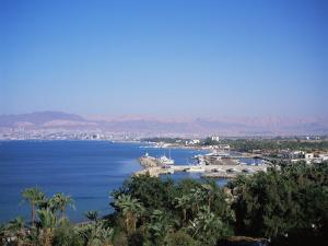 View Over Red Sea Resort Marina and Beach Hotels Towards Israeli Town of Eilat, Aqaba, Jordan by Christopher Rennie