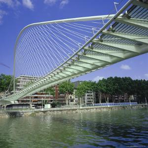 Zubizuri Curved Pedestrian Bridge Over Bilbao River, Bilbao, Pais Vasco (Vizcaya), Spain, Europe by Christopher Rennie