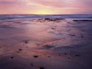 USA, California, San Diego, Sunset on Sand and Rocks by Christopher Talbot Frank