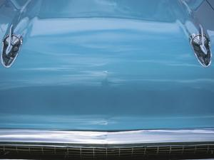 Chrome Decorations on Front of Blue Car