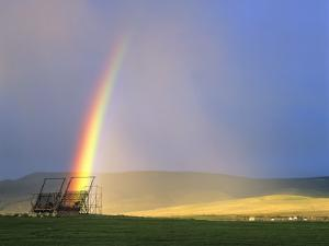 A Beaverslide Haystacker with Full Rainbow in the Big Hole Valley, Jackson, Montana, USA by Chuck Haney