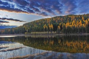 Autumn reflections in Spencer Lake near Whitefish, Montana, USA by Chuck Haney