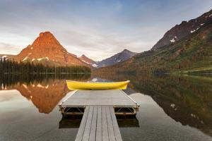 Boats on Calm Morning at Two Medicine Lake in Glacier National Park, Montana, USA by Chuck Haney