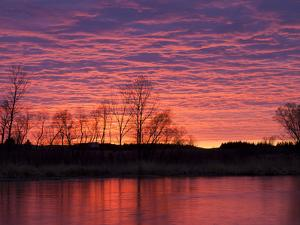 Brilliant Sunset Reflects into the Calamus River in Loup County, Nebraska, USA by Chuck Haney