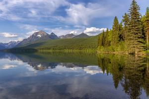 Calm reflection on Bowman Lake in Glacier National Park, Montana, USA by Chuck Haney