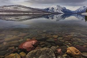Calm reflection on the first day of spring on Lake McDonald in Glacier National Park, Montana, USA by Chuck Haney