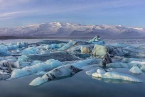 Calving icebergs in Jokulsarlon Glacier Lagoon in south Iceland by Chuck Haney