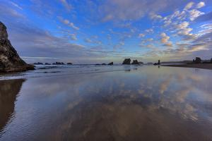 Clouds Reflect in Wet Sand at Sunrise at Bandon Beach, Bandon, Oregon by Chuck Haney