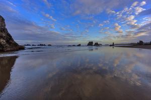 Clouds Reflect in Wet Sand at Sunrise at Bandon Beach, Bandon, Oregon by Chuck Haney