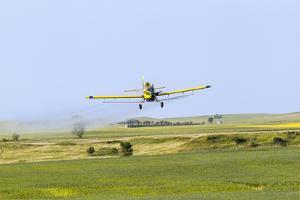 Crop Duster Airplane Spraying Farm Field Near Mott, North Dakota, USA by Chuck Haney